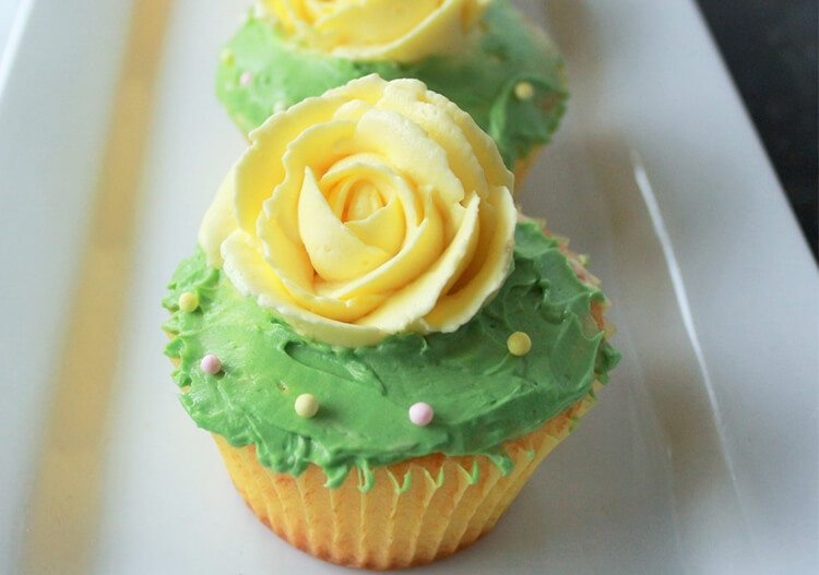 lemon cupcakes with floral decoration