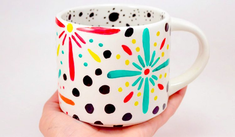 mugs painted in floral patterns