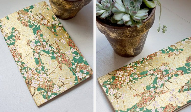 notebook covered in origami paper
